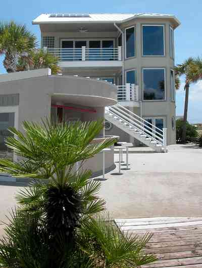 Navarre:-7332-Grand-Navarre-Blvd_08.jpg:  sego palm tree, cabana bar, beach house, deck