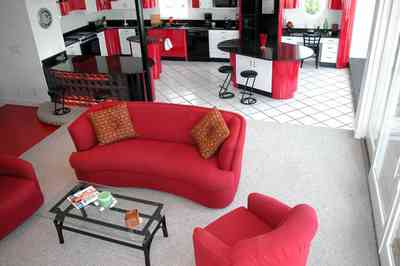 Navarre:-7332-Grand-Navarre-Blvd_20.jpg:  red lacquer cabinets, red and black, art deco decor, art deco house, kitchen, red kitchen cabinets, glass coffee table, glass brick bar, black laquer cabinets