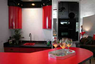 Navarre:-7332-Grand-Navarre-Blvd_27.jpg:  red lacquered cabinets, black laquered cabinets, art deco house, bar, kitsch, mirrored wall, bar glasses