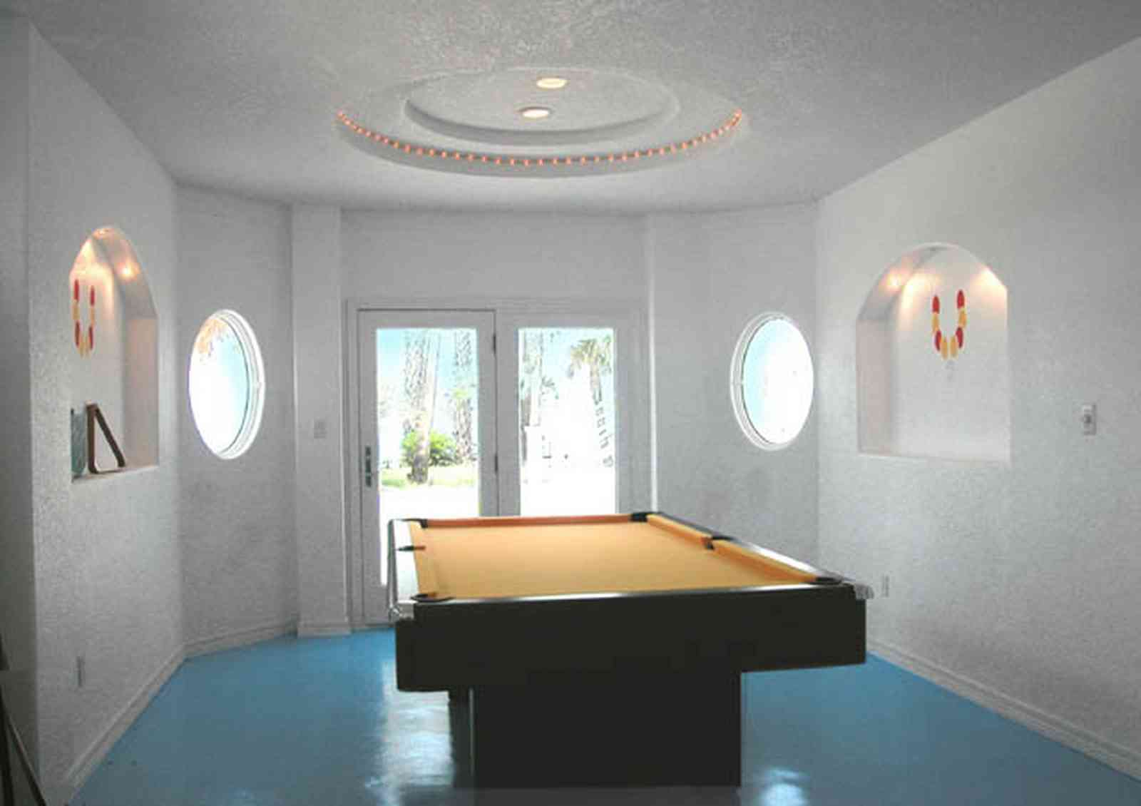 Navarre:-7332-Grand-Navarre-Blvd_65.jpg:  game room, pool room, art deco decor, painted floor, beach house, santa rosa sound