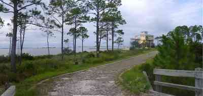 Navarre:-Biscayne-Pointe-Drive-House_05.jpg:  wetland, driveway, wooden bridge, house, escambia bay