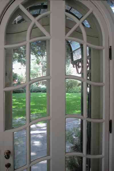 North-Hill:-105-West-Gonzales-Street_08a.jpg:  french door, leaded glass panes, archway, double door, entrance, florida sunroom