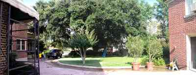 North-Hill:-105-West-Gonzales-Street_20.jpg:  driveway, red brick house, garage door, mud room, crepe myrtle tree, oak tree