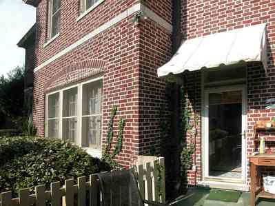 North-Hill:-105-West-Gonzales-Street_22a.jpg:  kitchen door, red brick house, picket fence, east entrance