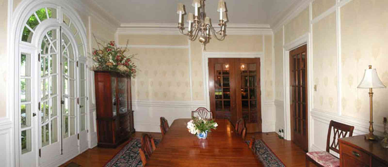 North-Hill:-105-West-Gonzales-Street_33b.jpg:  dining room, duncan phyfe furniture, chandelier, french doors,