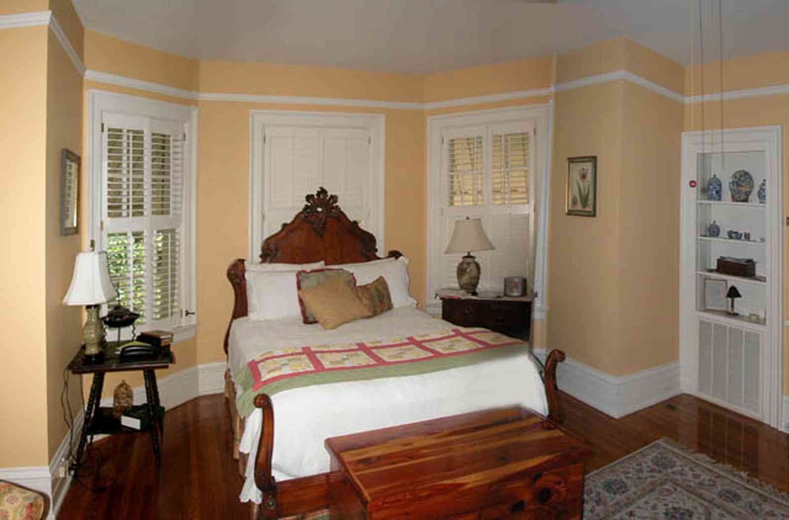North-Hill:-105-West-Gonzales-Street_62.jpg:  antique bed, cedar chest, oriental rug, shutters, awnings wainscotting, hardwood floor