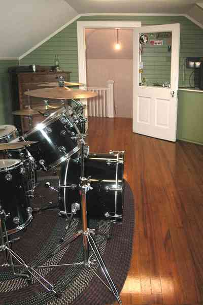 North-Hill:-105-West-Gonzales-Street_67.jpg:  attic bedroom, hooked rug, drum set, dormer room, hardwood floor