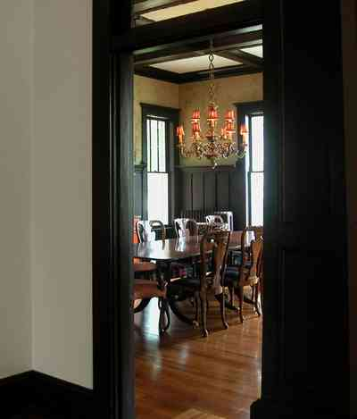 North-Hill:-116-DeSoto-St_02o.jpg:  heartpine floors, coffered ceilings, wainscotting, dining room table, chandelier