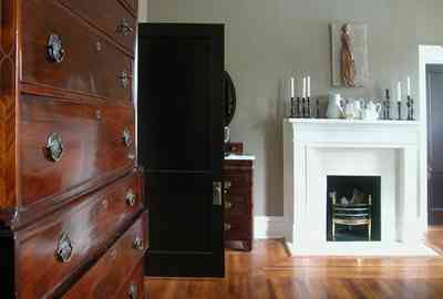 North-Hill:-116-DeSoto-St_02t.jpg:  bedroom, fireplace, mantle, highboy dresser, heartpine floor