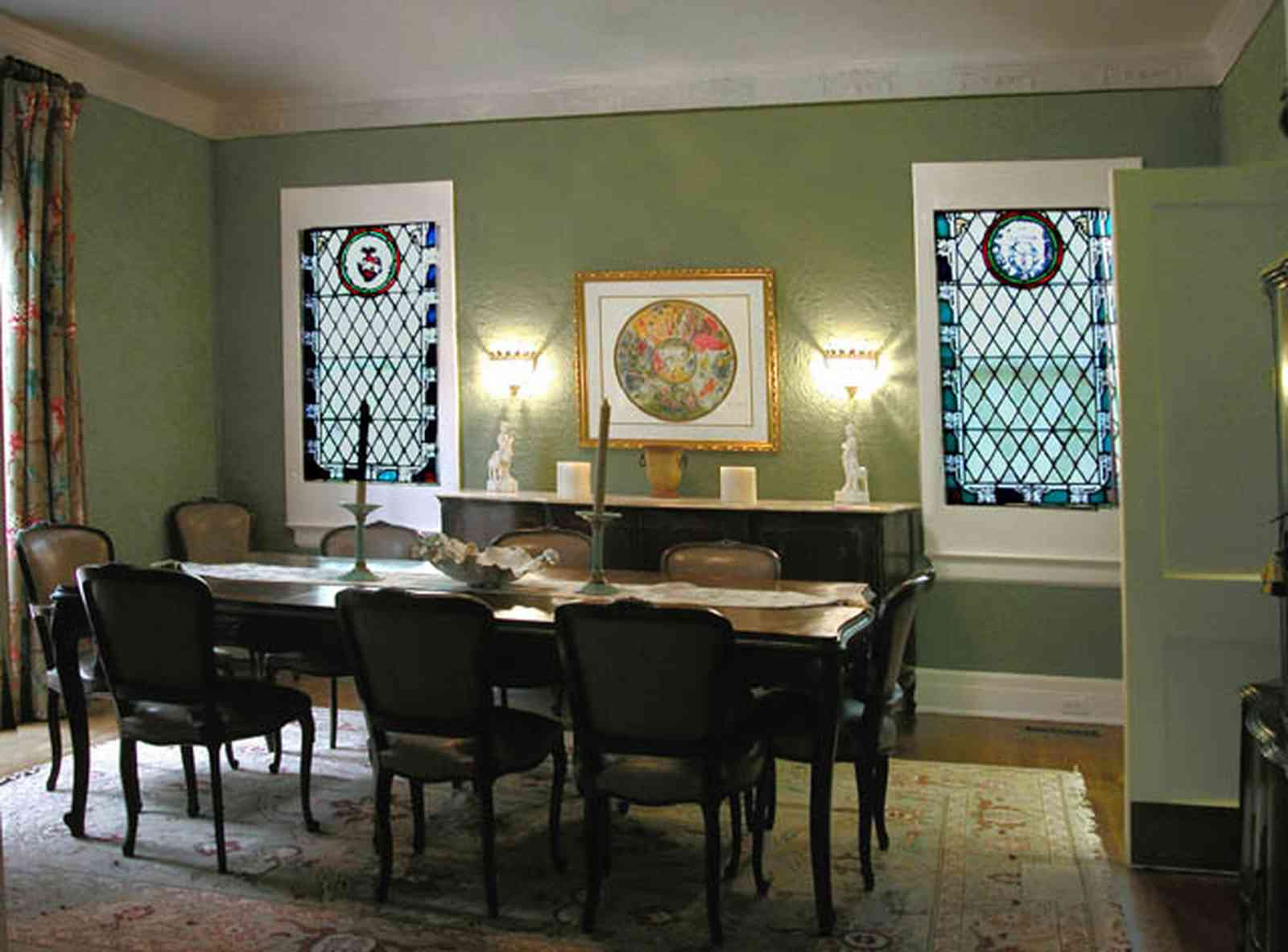 North-Hill:-123-West-Lloyd-Street_15.jpg:  dining room, stained glass windows, oriental rug, swinging door, drapes, front room, italienate architecture