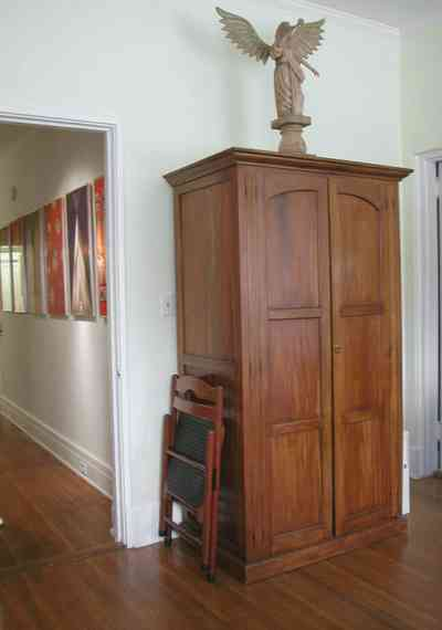 North-Hill:-123-West-Lloyd-Street_34.jpg:  guest bedroom, armoire, heart pine floors,