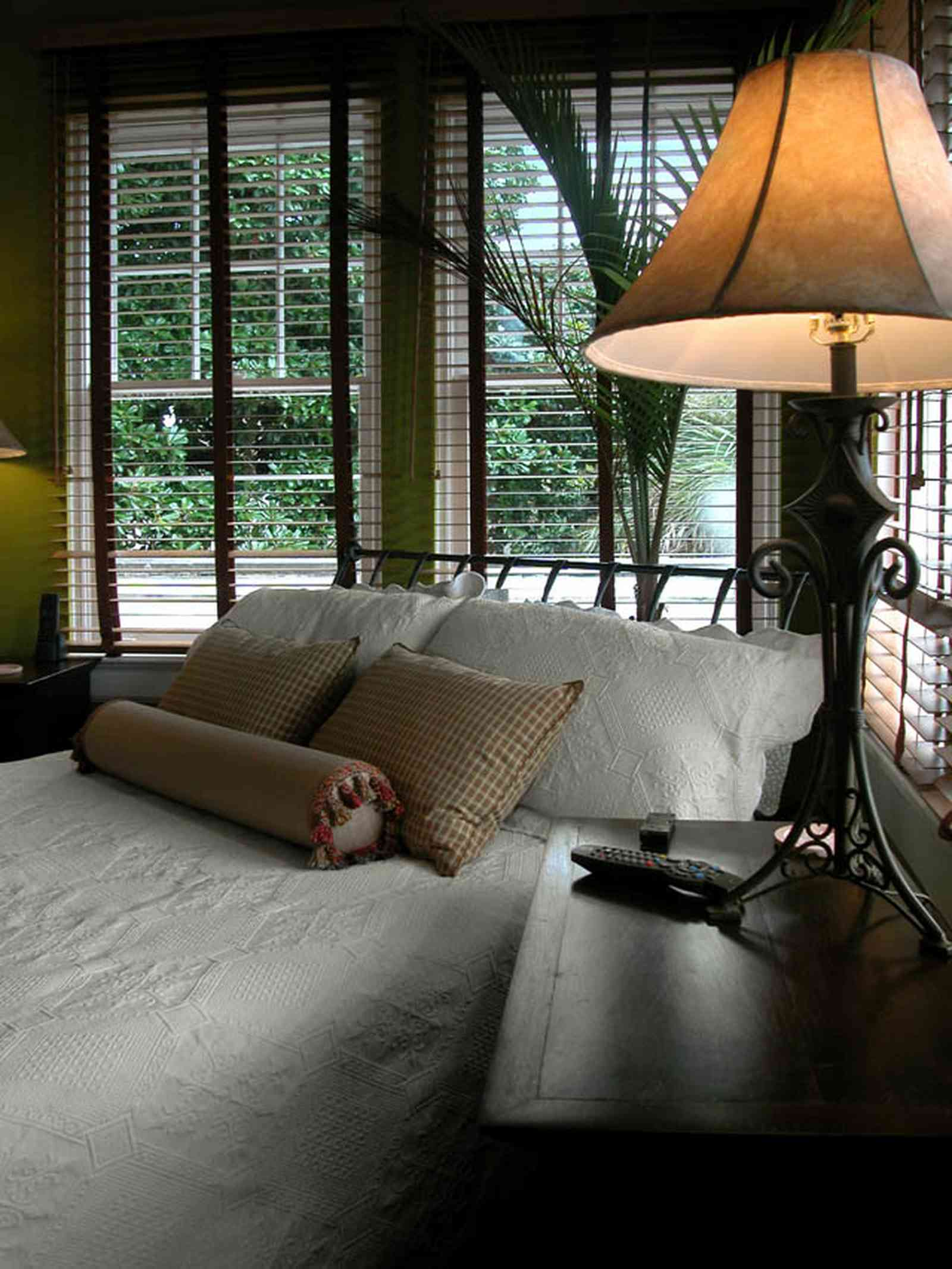 North-Hill:-123-West-Lloyd-Street_39.jpg:  master bedroom suite, wrought-iron bed, ventian blinds, wooden blinds