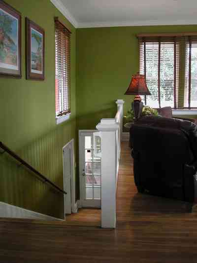 North-Hill:-123-West-Lloyd-Street_40.jpg:  french door, staircase, handrail, stairs, wooden blinds, ventian blinds, heartpine floors