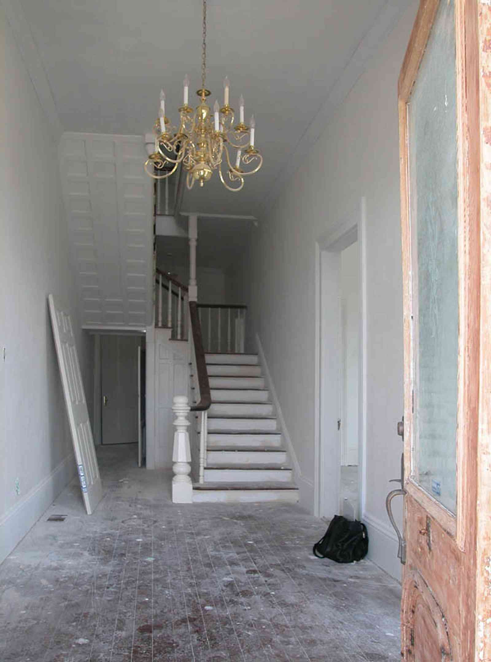 North-Hill:-200-West-Jackson-Street_02.jpg:  chandelier, heart-pine floors, etched glass door, staircase, victorian style, balloon frame construction