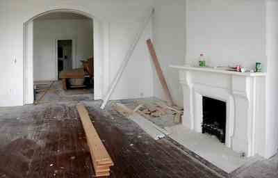 North-Hill:-200-West-Jackson-Street_04.jpg:  heartpine floors, mantel, fireplace, pocket doors, victorian home, arched door frame