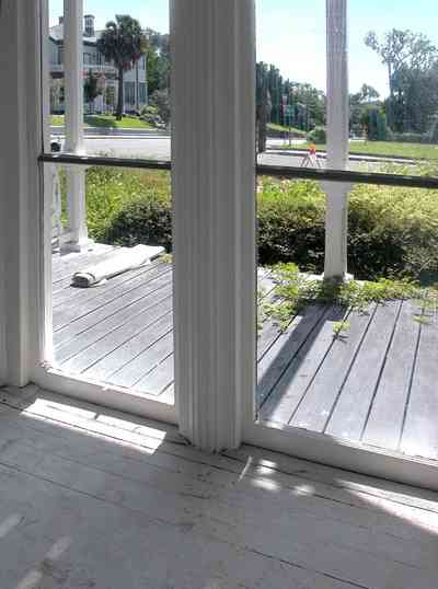 North-Hill:-200-West-Jackson-Street_13.jpg:  front porch, floor lenght windows, heartpine floors, palm tree, victorian house