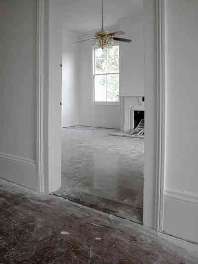 North-Hill:-200-West-Jackson-Street_28.jpg:  heart pine floor, ceiling fan, mantle piece, fireplace, front parlor
