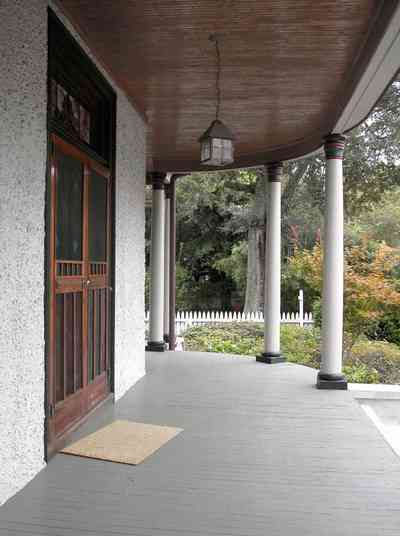 North-Hill:-304-West-Gadsden-Street_05.jpg:  columns, stucco walls, picket fence, magnolia tree, north hill preservation district, front door, screen door, stained glass transom