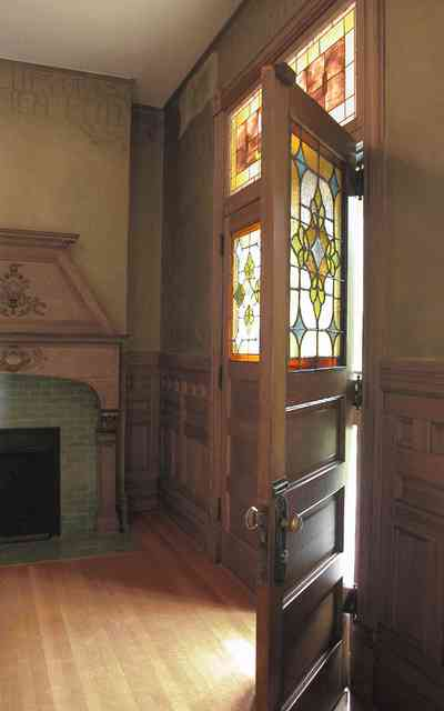 North-Hill:-304-West-Gadsden-Street_07.jpg:  carved oak mantle, stained glass transom, front door, wainscotting, heartpine flooring, north hill preservation district, faux walls stenciled borders