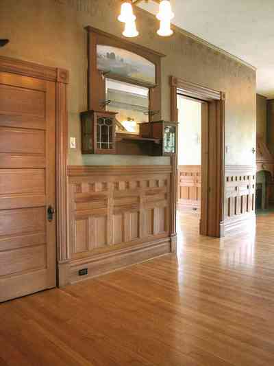 North-Hill:-304-West-Gadsden-Street_13.jpg:  central hall, oak wainscotting, faux wall, stenciled borders, dining room, heartpine floors