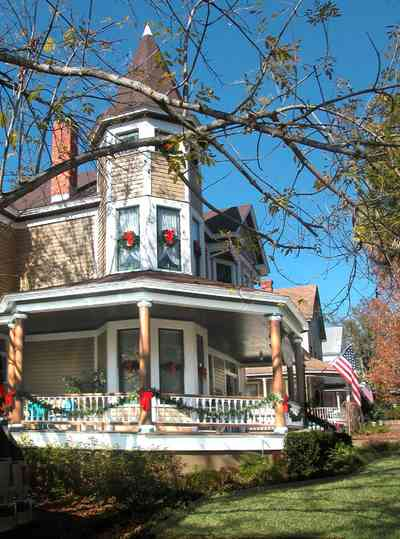 North-Hill:-Springhill-Guest-House_02.jpg:  victorian house, front porch, columns, turret, fireplace, guest house, hotel, bed and breakfast,