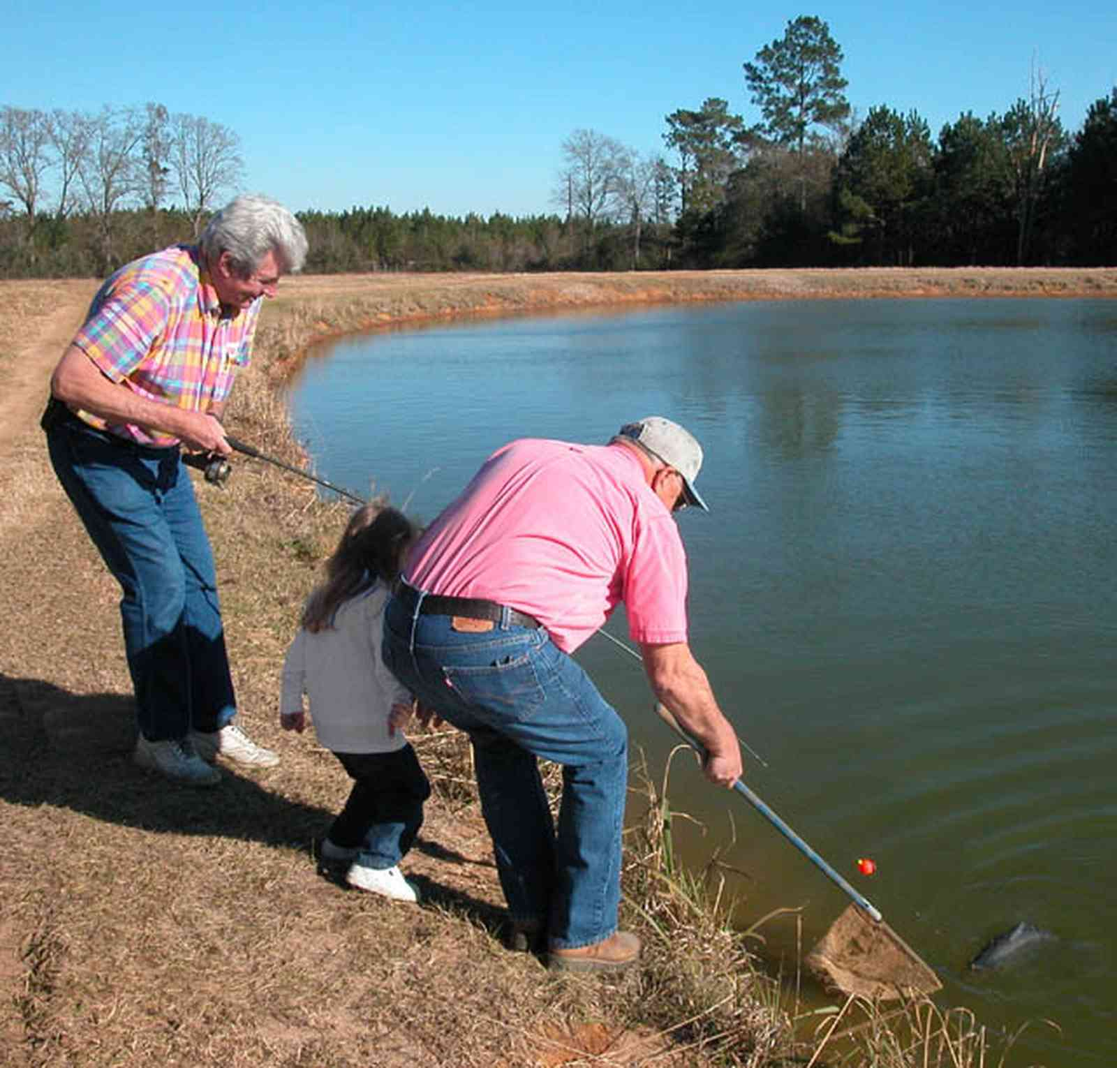Oak-Grove:-Carpenters-Catfish-Farm_01aa.jpg:  catfish pond, hook, fisherman, deep water well
