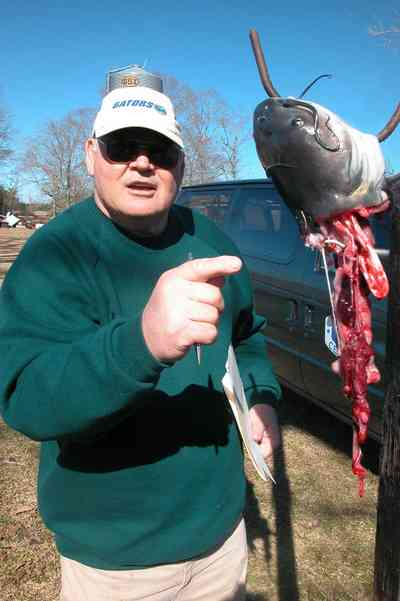 Oak-Grove:-Carpenters-Catfish-Farm_14.jpg:  entrails, catfish cleaning, gaffing hook