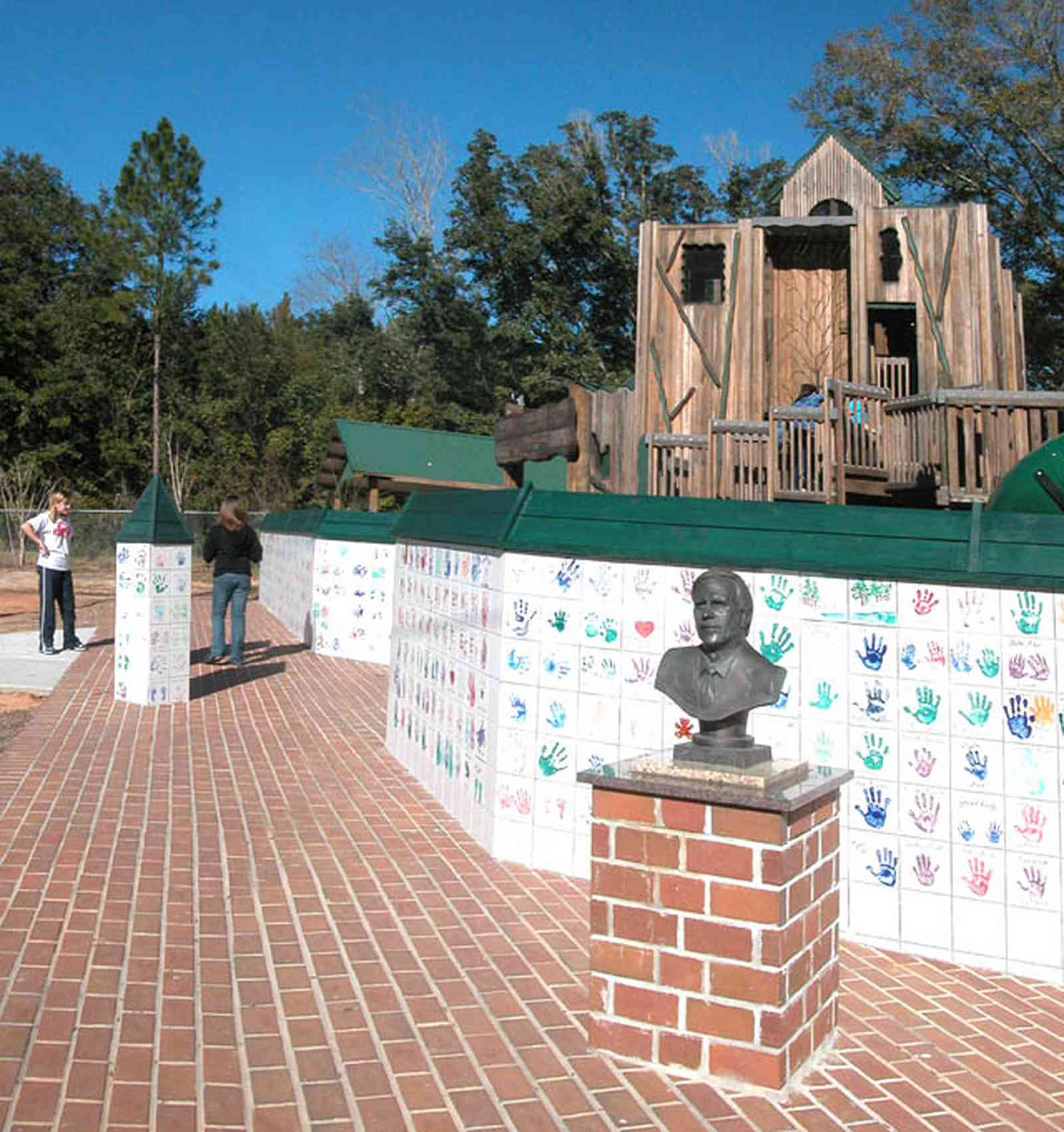 Pace:-Benny-Russell-Park_01-copy.jpg:  playground equipment, bust, statue, climbing, commemorative wall