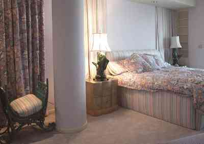 Pensacola-Beach:-1212-Ariola-Drive_10.jpg:  master bedroom, fish lamps, 50's lamps, dense carpet, beach house