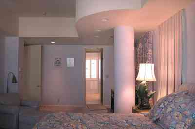 Pensacola-Beach:-1212-Ariola-Drive_11.jpg:  beach house, gulf of mexico, pensacola beach, curved walls, pleated drapes, fish lamp, 1950's lamp
