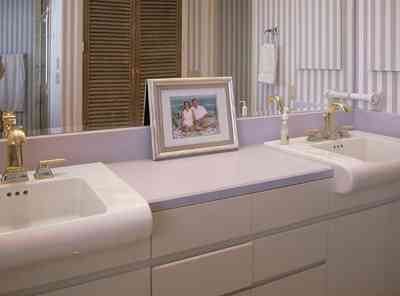Pensacola-Beach:-1212-Ariola-Drive_12.jpg:  master bathroom, louvered door, striped wallpaper, beach house, framed family portrait