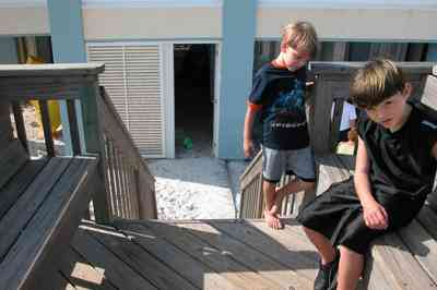 Pensacola-Beach:-1212-Ariola-Drive_30.jpg:  stairs, deck, louvered door, bench, pensacola beach, quartz sand