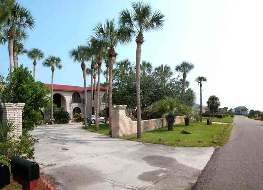 Pensacola-Beach:-237-Sabine-Drive_01.jpg:  meditterean architectural style, 1970's architecture, greek statue, palm tree, circular driveway, brick house