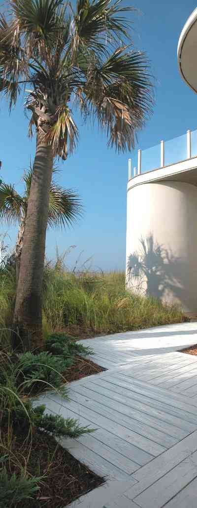 Pensacola-Beach:-Ariola-Drive-Art-Deco-House_10a.jpg:  sand, crystal sand, white sand, sugar sand, sea oats, bauhaus architectural style, palm trees, dune restoration, stairs, glass railing, wooden deck, beachfront property