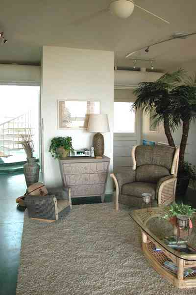 Pensacola-Beach:-Ariola-Drive-Art-Deco-House_17a.jpg:  coffee table, chairs, lamp, palm tree, circular stairs, beachfront home, geothermal heating system
