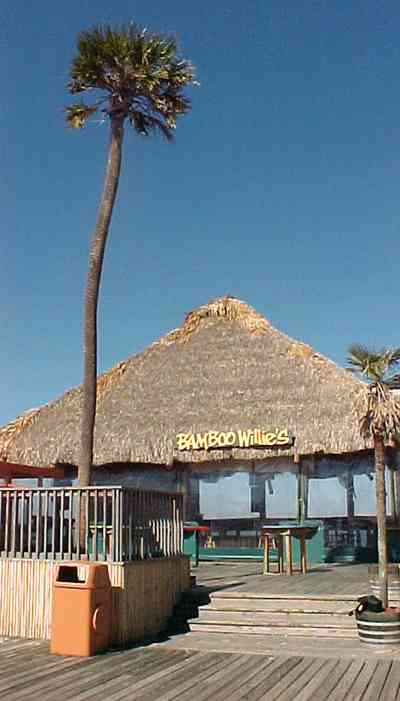 Pensacola-Beach:-Bamboo-Willies_02.jpg:  bamboo hut, tropical island, palm trees, bar, restaurant, alcohol, gulf of mexico, sound