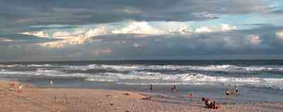 Pensacola-Beach:-Casino-Beach_01b.jpg:  surf, waves, beach front, cumulus clouds, storm surge, bathers, swimmers, gulf of mexico, tropical storm, mixed skies,