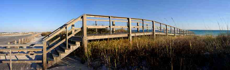 Pensacola-Beach:-Escambia-County-Parking-Lot_02.jpg:  boardwalk, walkover, sea oats, cordgrass, parking lot, gulf of mexico