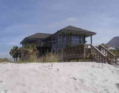 Pensacola-Beach:-Hermosa-St-Homes_09.jpg:  sea oats, sand dunes, palm trees, boardwalk, gulf of mexico