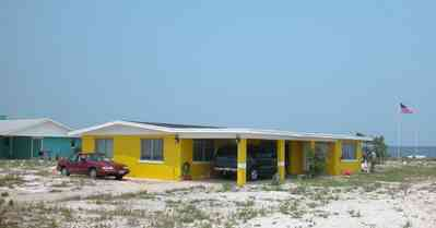 Pensacola-Beach:-Rio-Vista-Drive_06.jpg:  cement block house, yellow house, 1950's architecture, beach front house, pensacola bay