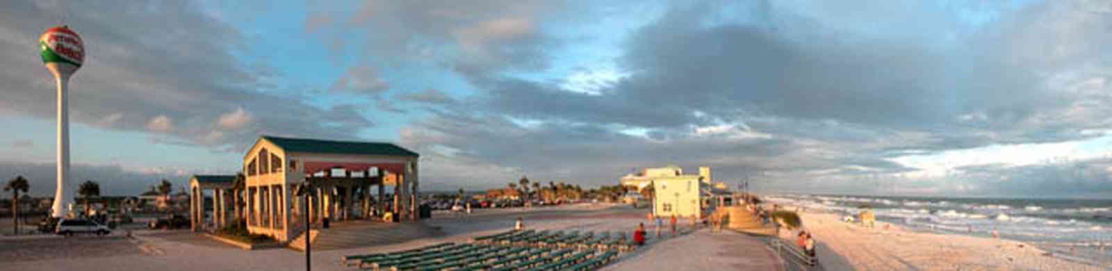 Pensacola-Beach:-Sunset_06.jpg:  pavillion, amphitheater, concert stage, benches, beach front, gulf of mexico, waves, surf, surfers, beach ball, water tower, parking lot,