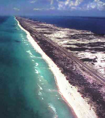 Pensacola-Beach:-Waterfront_10.jpg:  santa rosa island, gulf of mexico, seashore, dune, road, white sand, quartz sand crystal, wave, surf, barrier island, santa rosa sound, aerial view