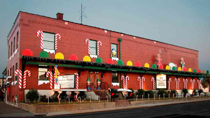 Pensacola:-Downtown:-Brown,-Thornton,-Pacenta-And-Company-P.A._01.jpg:  candy canes, gum drops, elves, twinkling lights, brick building, amour meat packing plant, downtown, christmas decorations