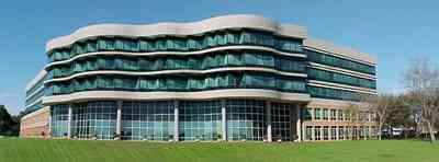 Pensacola:-Gateway-District:-Gulf-Power-Headquarters_01.jpg:  corporate headquarters, corporate building, bayfront parkway, green glass windows