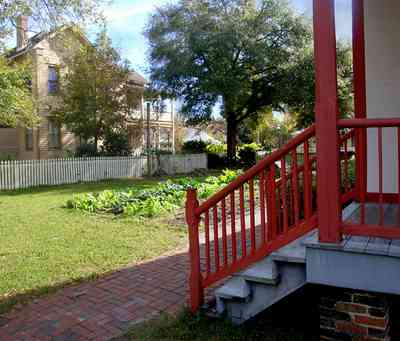 Pensacola:-Historic-Pensacola-Village:-LaValle-House_03.jpg:  kitchen garden, greens, turnips, lettuce, porch, picket fence