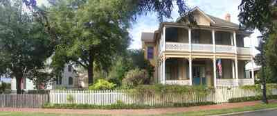 Pensacola:-Historic-Pensacola-Village:-Lear-Rocheblave-House_02.jpg:  victorian house, victorian front porch, white picket fence, historic village, oak tree