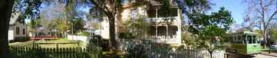 Pensacola:-Historic-Pensacola-Village:-Lear-Rocheblave-House_06.jpg:  victorian house, trolley, white picket fence, gingerbread trim, historic village, museum complex