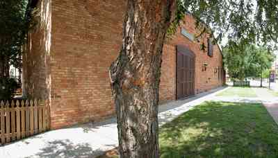 Pensacola:-Historic-Pensacola-Village:-Museum-Of-Commerce_03.jpg:  river birch tree, picket fence, museum, warehouse, historic district