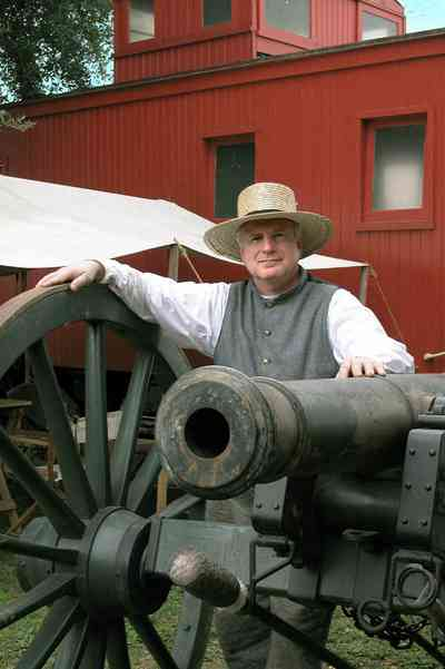 Pensacola:-Historic-Pensacola-Village:-Museum-Of-Industry_01b.jpg:  cannon, historic reenactment, civil war soldier, caboose, train, museum, tent, encampment
