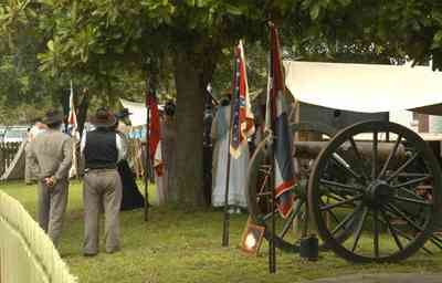 Pensacola:-Historic-Pensacola-Village:-Museum-Of-Industry_01bb.jpg:  historic reenactment, flags, cannon, tent, civil war soldiers, picket fence